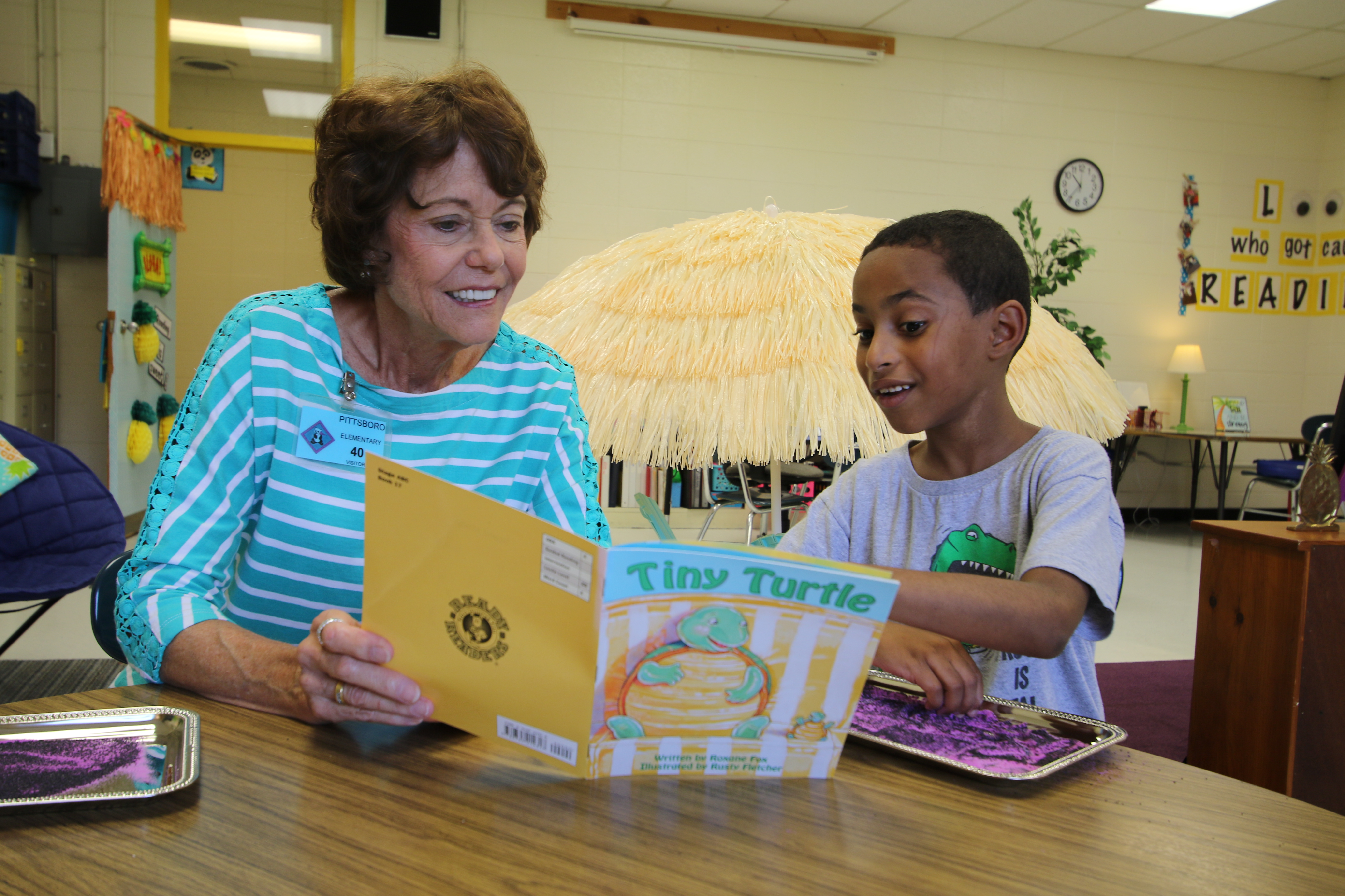 A volunteer reads to an Chatham County Schools student.