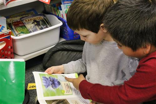 Silk Hope School students work through a book donated through the Reindeer Readers program.