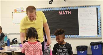 It's the first year of second grade for the teacher and his students.