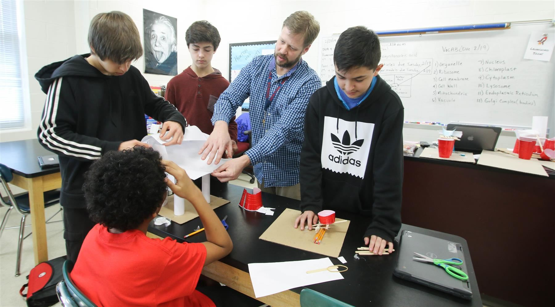 Horton Middle School teacher Michael Moore helps students with engineering concepts.