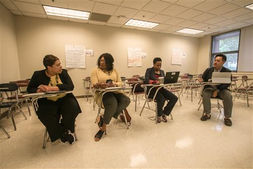 Joash Chung (far right) is with educators preparing to provide interviewing tips to N.C. Central University students.