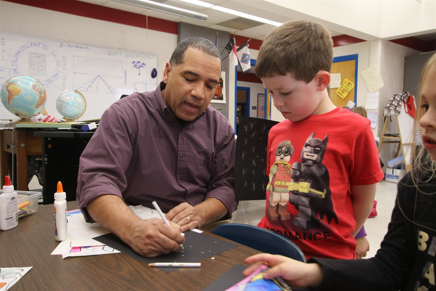 Arts educator Darren Wellman works with a student at Pittsboro Elementary School.