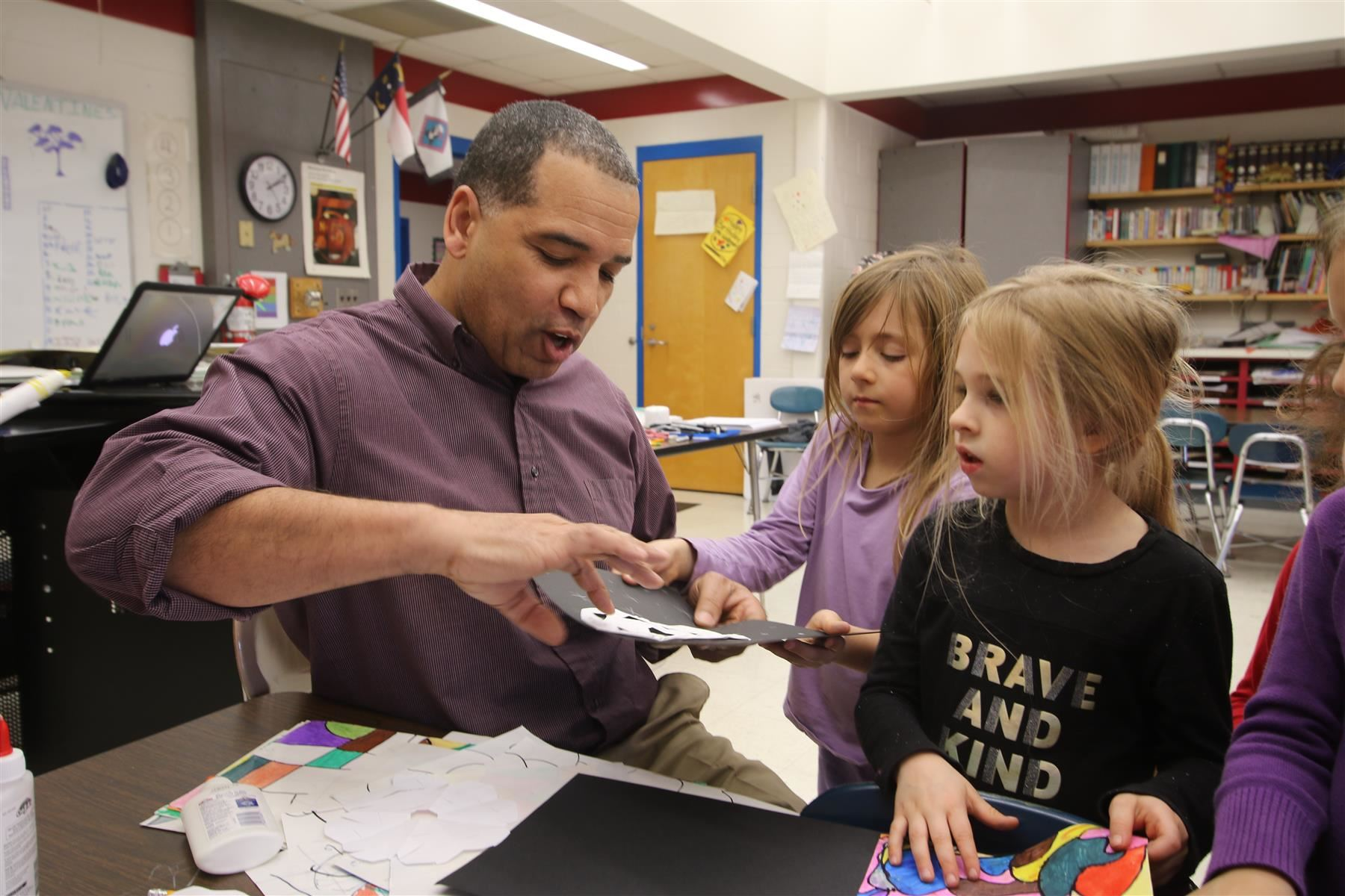 Darren Wellman works with students at Pittsboro Elementary School.