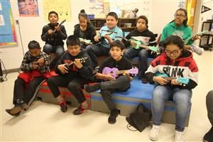Virginia Cross Elementary School students are learning to play the ukulele in Mary Clayton Jolicouer's class April 1, 2109.