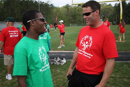 Northwood High School educator Jason Amy (right) chats with Special Olympian Tyrone Glover.
