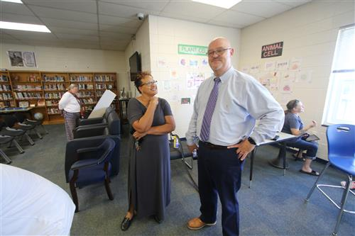 Chatham Central High School Principal Karla Eanes chats with Chatham School of Science & Engineering Principal Bobby Dixon.