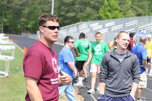 Northwood High School educator Jason Amy (left) empowers students to coordinate the Chatham County Special Olympics.