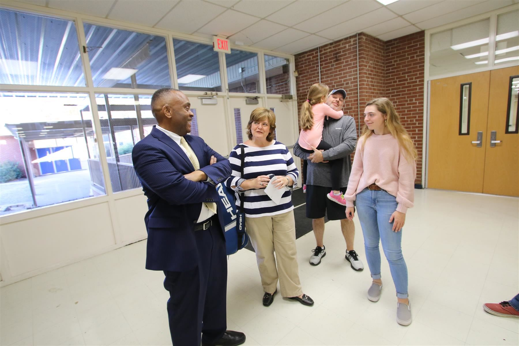 Rep. Robert Reives gathers with Lindley Andrew and her family at Jordan-Matthews High School Nov. 25, 2019.
