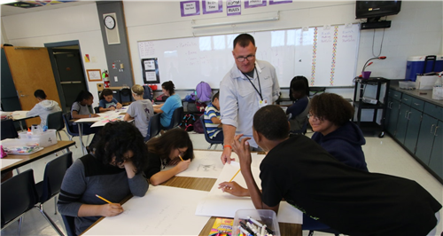 Chatham Middle School art teacher Mike White guides students during a drawing assignment.