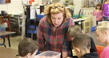 Laura Newman, who teaches visual arts, is working with students at J.S. Waters School.