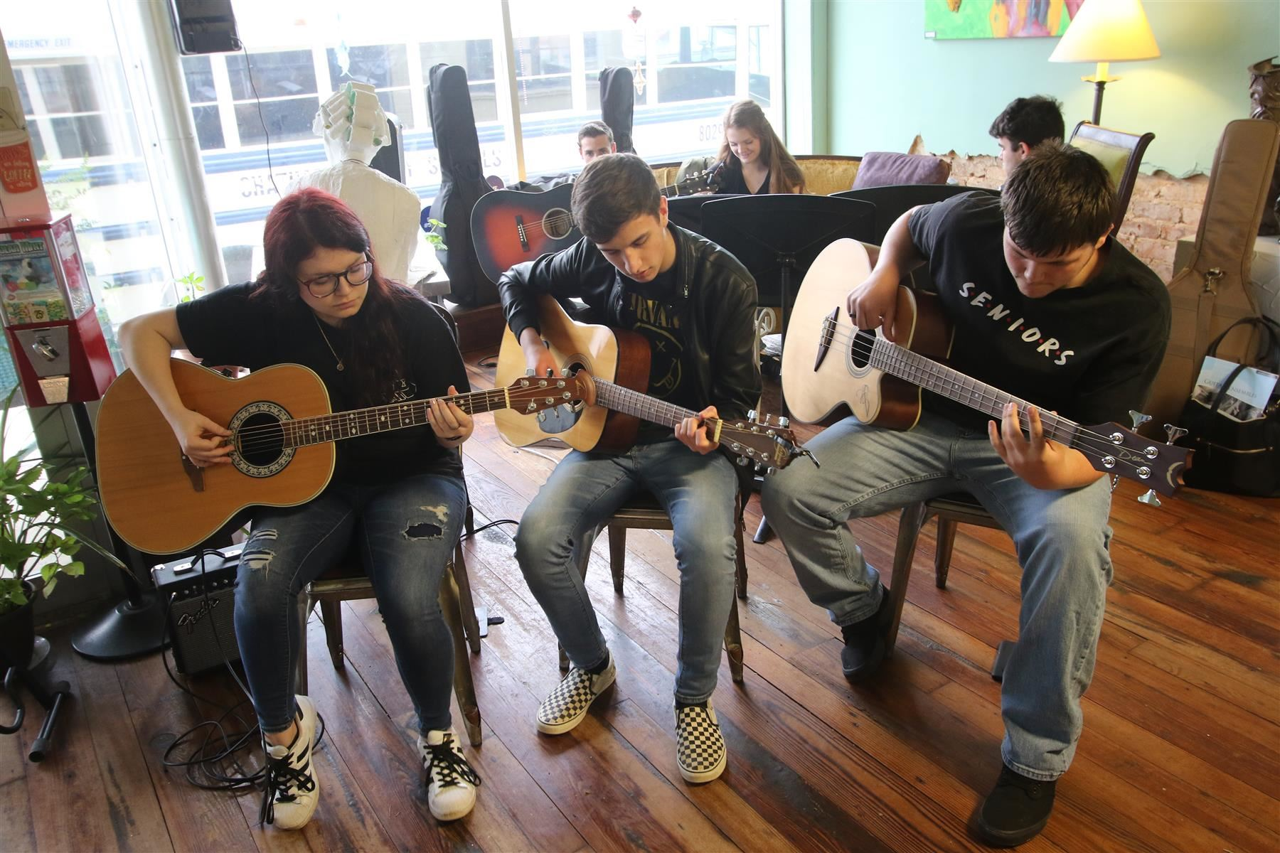 The Chatham Central High School Guitar Ensemble performs at Peppercorn in downtown Siler City on March 26, 2019.