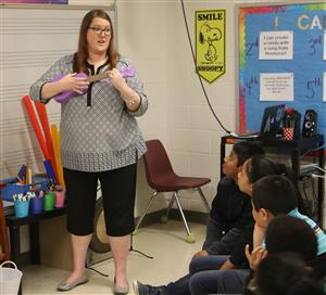 Virginia Cross Elementary School music teacher Mary Clayton Jolicouer demonstrates ukulele techniques April 2, 2019.